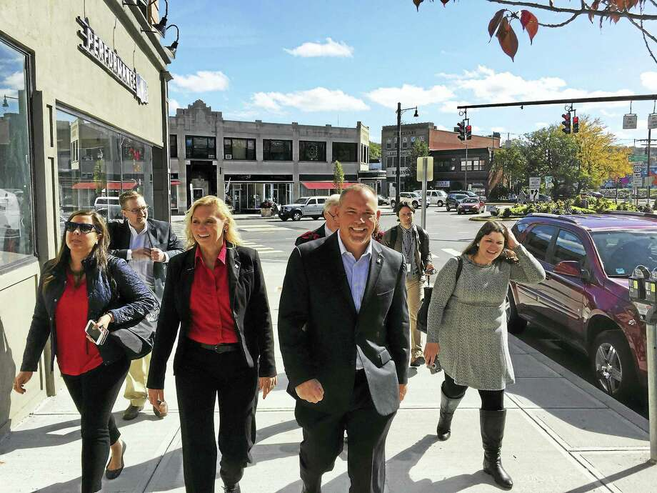 Ben Lambert - The Register CitizenHouse Majority Leader Joe Aresimowicz (D-Berlin), Rep. Michelle Cook (D-65), and William Riiska, the Democratic candidate to represent the 65th district visited businesses in downtown Torrington Wednesday. Photo: Digital First Media