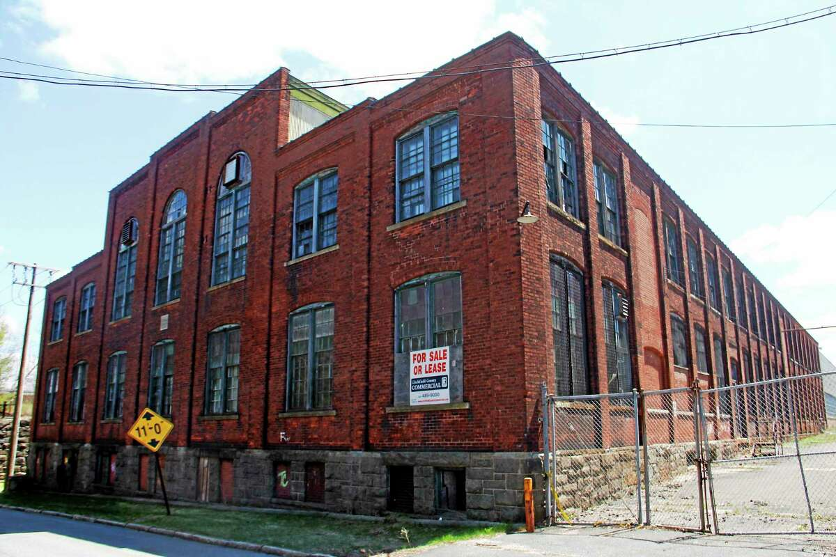 One of two buildings set for demolition by the state to make way for the new transit district maintenance center.