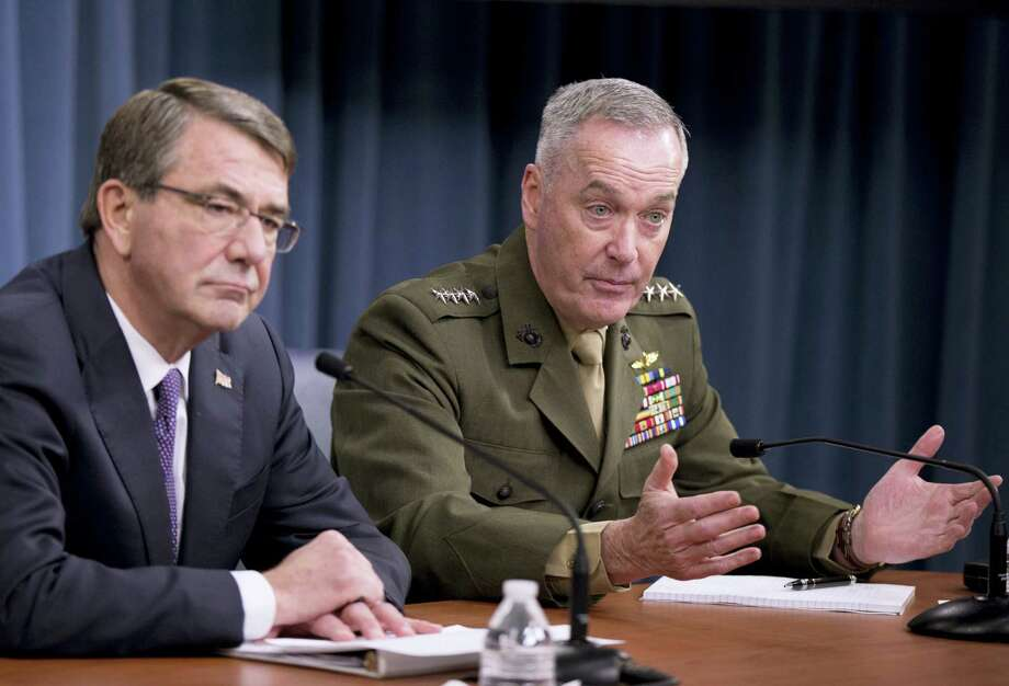 Joint Chiefs Chairman Gen. Joseph Dunford, right, with Defense Secretary Ash Carter, speaks during a news conference at the Pentagon, Friday, March 25, 2016, where they announced U.S. forces killed a senior Islamic State leader, among several key members of the militant group eliminated this week. Photo: AP Photo — Mauel Balce Ceneta / AP