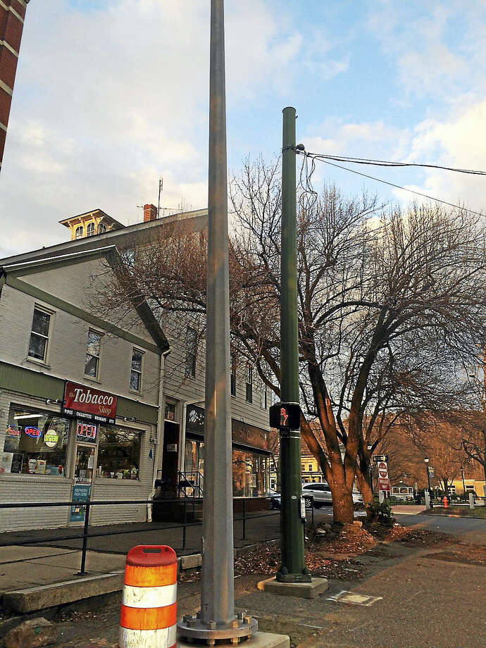 The steel and green span poles on the intersection of Main Street and Rowery Street in Winsted. Photo: Noelia Ortiz — The Register Citizen