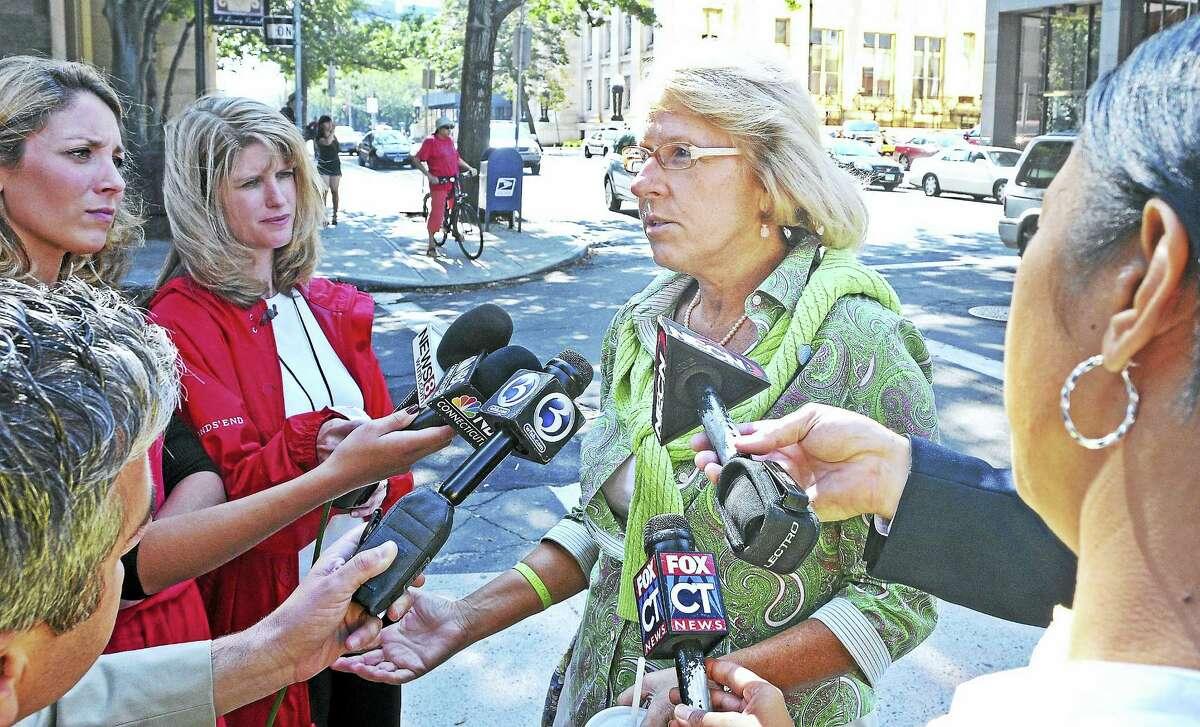 (File photo) Cindy Hawke-Renn, sister of Jennifer Hawke-Petit speaks to reporters during the trial of Joshua Komisarjevsky in 2011.