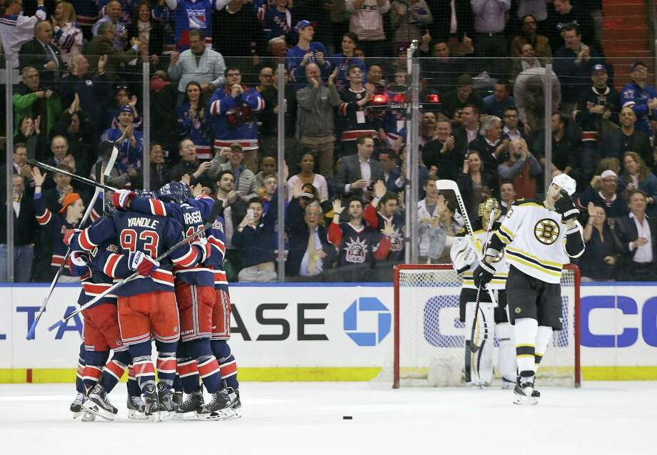 Boston Bruins goalie Tuukka Rask (40) and teammate Zdeno Chara (33) watch as the New York Rangers celebrate a goal by Derek Stepan during the first period Wednesday. Photo: The Associated Press  / AP