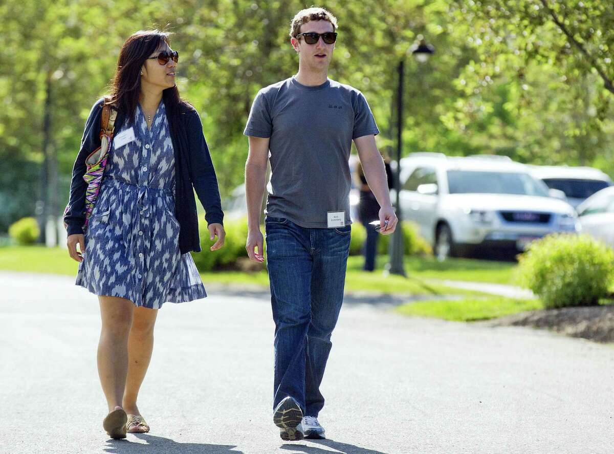 AP Photo/Julie Jacobson In this July 9, 2011 photo, Mark Zuckerberg, president and CEO of Facebook, walks to morning sessions with his then girlfriend Priscilla Chan during the 2011 Allen and Co. Sun Valley Conference, in Sun Valley, Idaho.