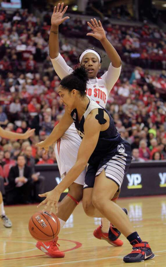 UConn's Gabby Williams drives to the basket against Ohio State's Ameryst Alston on Monday in Columbus, Ohio. Photo: Jay LaPrete — The Associated Press  / FR52593 AP