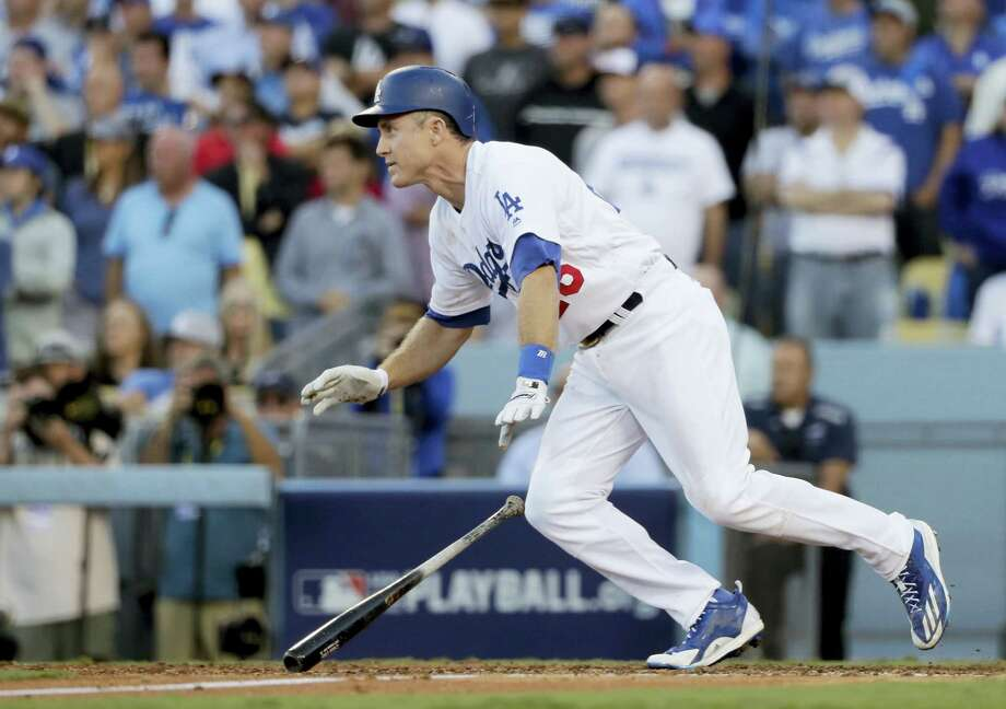 Los Angeles' Chase Utley watches his RBI single during the eighth inning in Game 4 of THE National League Division Series against the Washington Nationals in Los Angeles Tuesday. The Dodgers won 6-5. Photo: JAE C. HONG — THE ASSOCIATED PRESS  / Copyright 2016 The Associated Press. All rights reserved.