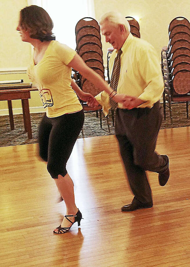 "Litchfield First Selectman Leo Paul and dancing partner Lisa Spiro of Hartford Ballroom practice some moves to Pharrell Williams' ""Happy"" for their upcoming ""Dancing with the Northwest CT Stars"" event on April 2. Photo: Catherine Guarnieri — Litchfield County Times"