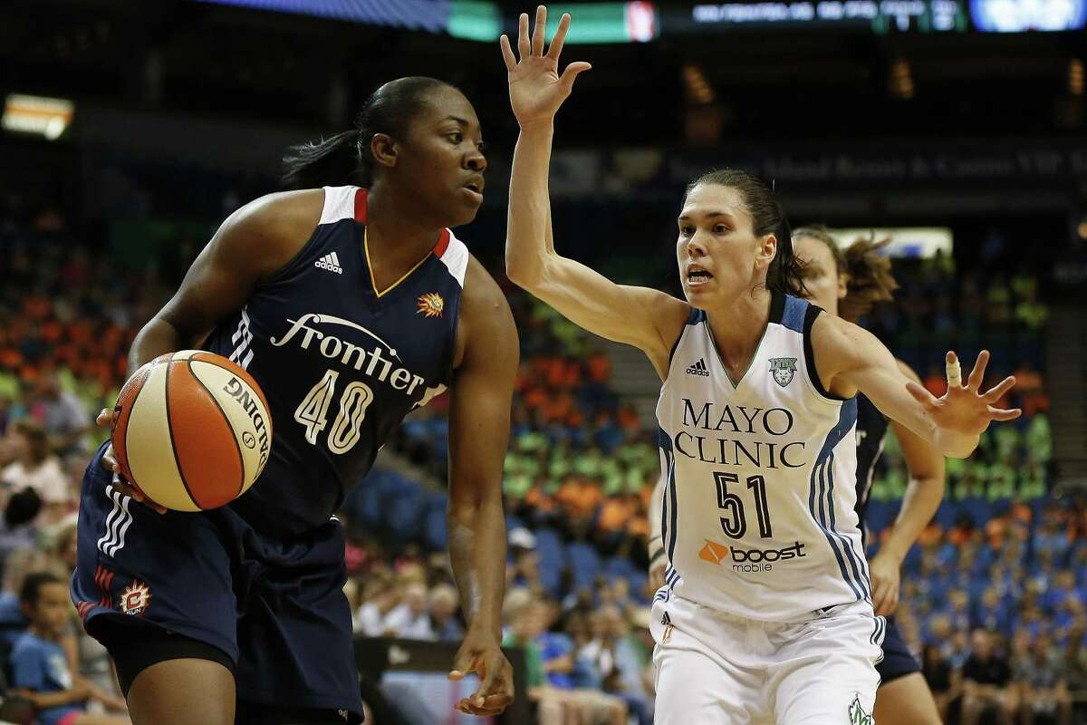 Connecticut forward Shekinna Stricklen, left, drives by Minnesota Lynx guard Anna Cruz during the Sun's 78-77 overtime victory on Wednesday afternoon in in Minneapolis.