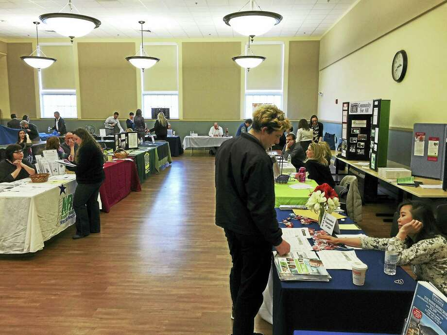 Job seekers took part in the annual job fair organized by the Northwest Connecticut Chamber of Commerce Wednesday. Photo: BEN LAMBERT – The Register CItizen