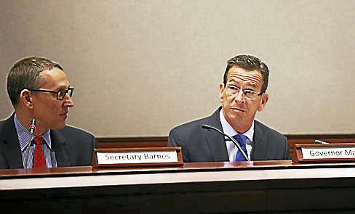 Gov. Dannel P. Malloy chairs the state Bond Commission meeting Thursday.
