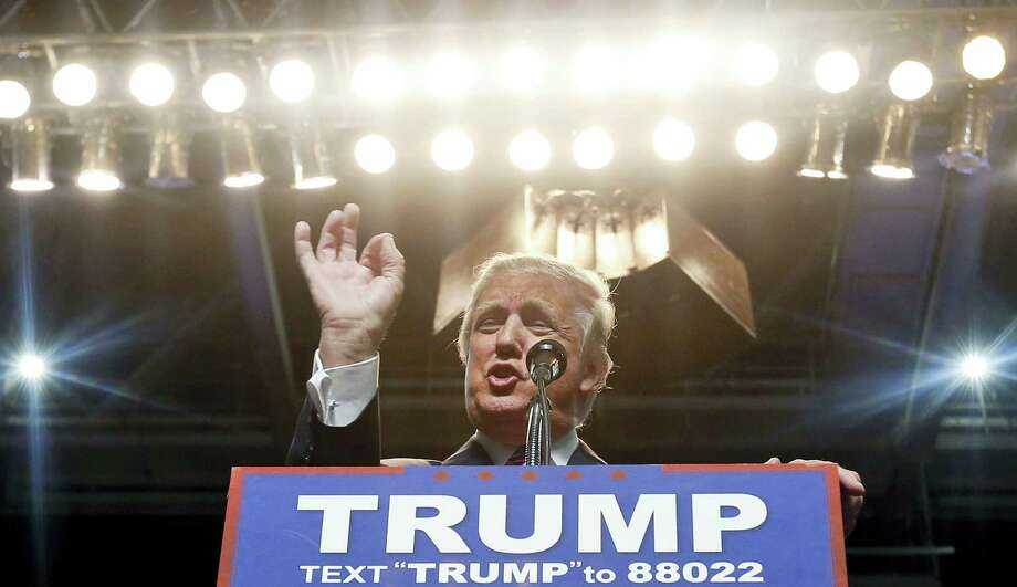 In this May 5, 2016 photo, Republican presidential candidate Donald Trump gestures during a rally in Charleston, W.Va. Despite what Trump's campaign describes as comprehensive background checks, Trump has failed to detect problems with his partners — including ex-cons, a man fleeing bankruptcy fraud charges and the scion of a family suspected by U.S. diplomats of Iranian money laundering. Photo: AP Photo/Steve Helber  / Copyright 2016 The Associated Press. All rights reserved. This material may not be published, broadcast, rewritten or redistribu