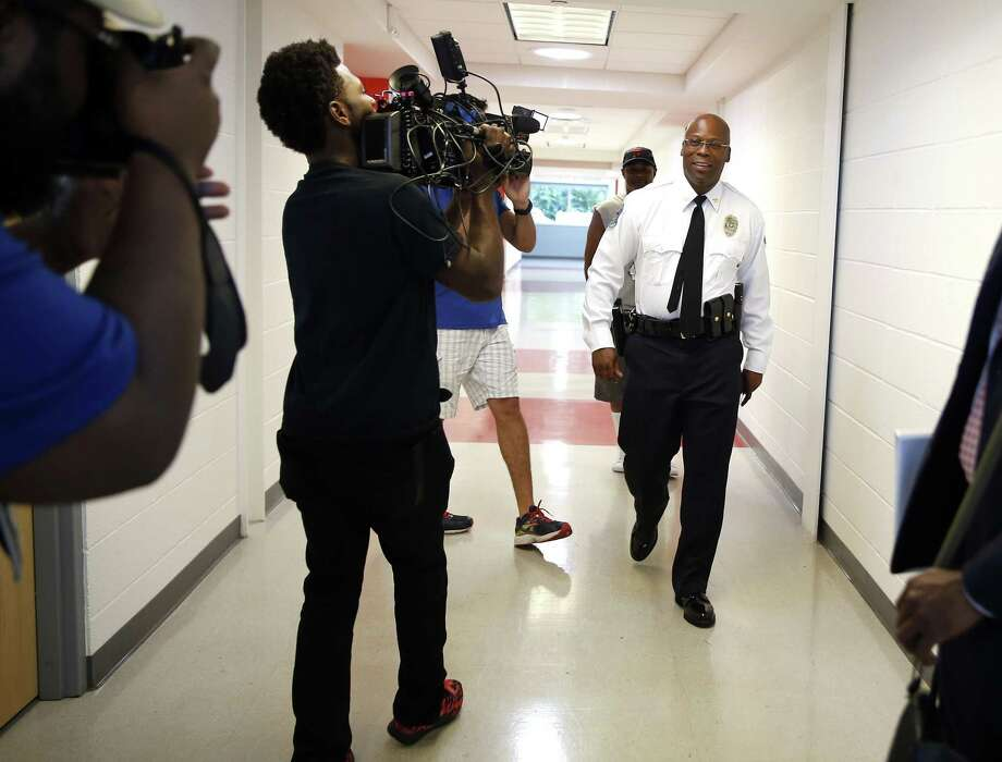 Andre Anderson walks through the halls of the Ferguson Community Center following a news conference announcing him as the interim police chief of the Ferguson Police Department Wednesday, July 22, 2015, in Ferguson, Mo. Photo: (AP Photo/Jeff Roberson) / AP