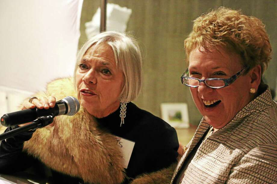 Vita West Muir, left, executive director of Litchfield Performing Arts, was given a CultureMAX Lifetime Achievement Award for her work establishing the Litchfield Jazz Festival, Litchfield Jazz Camp and more. With her is JoAnn Ryan, Northwest Connecticut's Chamber president and CEO, as well as mistress of ceremonies at the Northwest Connecticut Arts Council presentation at Morrison Gallery in Kent on Tuesday night. Photo: John Fitts — The Register Citizen