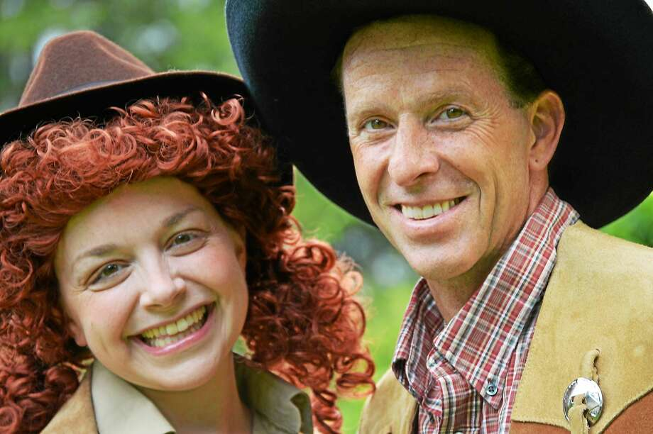 """Photo by Thom Keough L. Nagle (Torrington) takes aim as legendary sharpshooter Annie Oakley and Robert Bria (Redding) is her Wild West Show rival and love interest in """"Annie Get Your Gun,"""" the Irving Berlin musical classic, playing July 24 – Aug. 8 at Musicals at Richter, 100 Aunt Hack Road, in Danbury. For tickets and information, visit www.musicalsatrichter.org, leave a message at 203-743-6873 or email info@musicalsatrichter.org. Photo: Journal Register Co."""