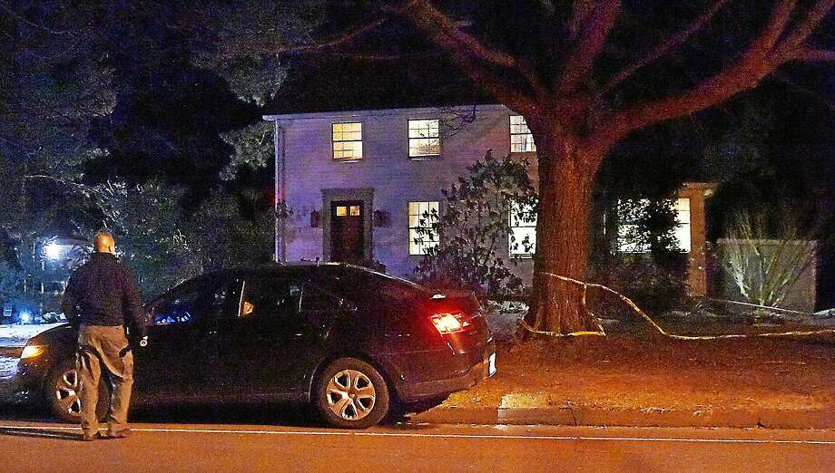 "Connecticut State Police investigate what they said was ""an apparent murder-suicide"" at an artist's studio in a home on Main Street in Durham late Tuesday evening. The home is across from the Town Green. Photo: Catherine Avalone — New Haven Register  / New Haven RegisterThe Middletown Press"