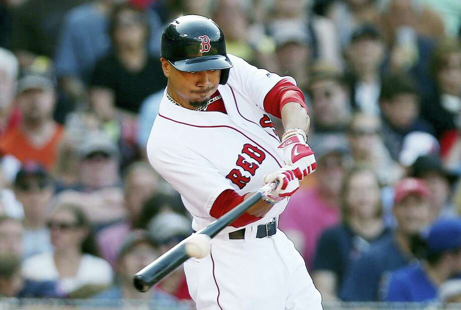 Mookie Betts connects on an RBI-single during the fourth inning Saturday. Photo: Michael Dyer — The Associated Press  / Copyright 2016 The Associated Press. All rights reserved. This material may not be published, broadcast, rewritten or redistribu