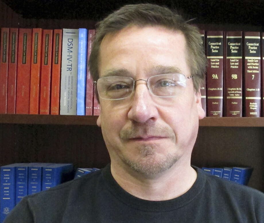 In this March 21, 2016 photo, Derek Oatis poses at his law office in Manchester, Conn. As teenagers in the 1980s, Oatis and his girlfriend were arrested for bringing about two pounds of cocaine from Venezuela to the U.S., where Oatis planned to sell it at Choate Rosemary Hall, an elite boarding school that he attended in Wallingford, Conn. Photo: AP Photo/Dave Collins  / AP