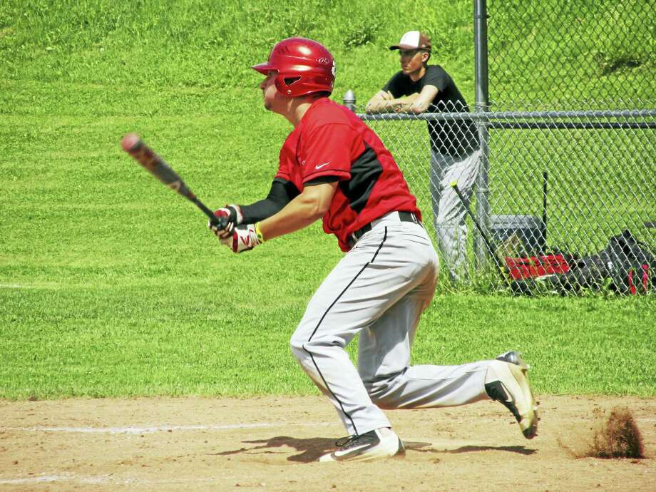 Photo by Peter WallaceNorthwestern's Tony Pucino, in a monster day at bat, watches another shot go deep in a big win over Stonington Saturday afternoon at Northwestern High School. Photo: Journal Register Co.