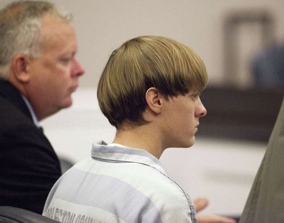 Dylann Roof appears at a court hearing in Charleston, S.C., on Thursday, July 16, 2015. A judge ruled Thursday that Roof, accused of killing nine people at the Emanuel AME Church in Charleston in June, will stand trial in July, 2016. Photo: (Randall Hill, Pool Photo Via AP)   / POOL Reuters