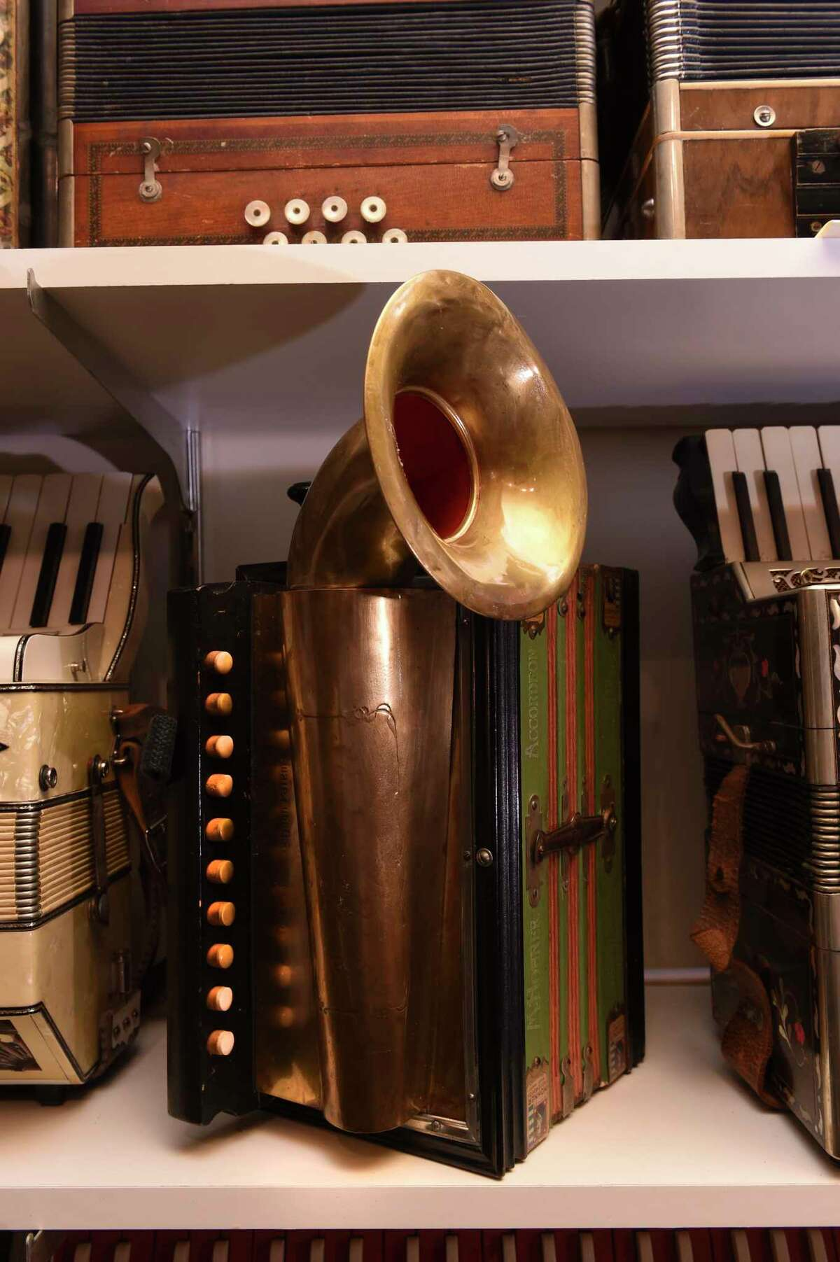 Paul Ramunni transformed his two car garage into a room packed with vintage and unusual accordions. Along the way he collected stories from the former owners.