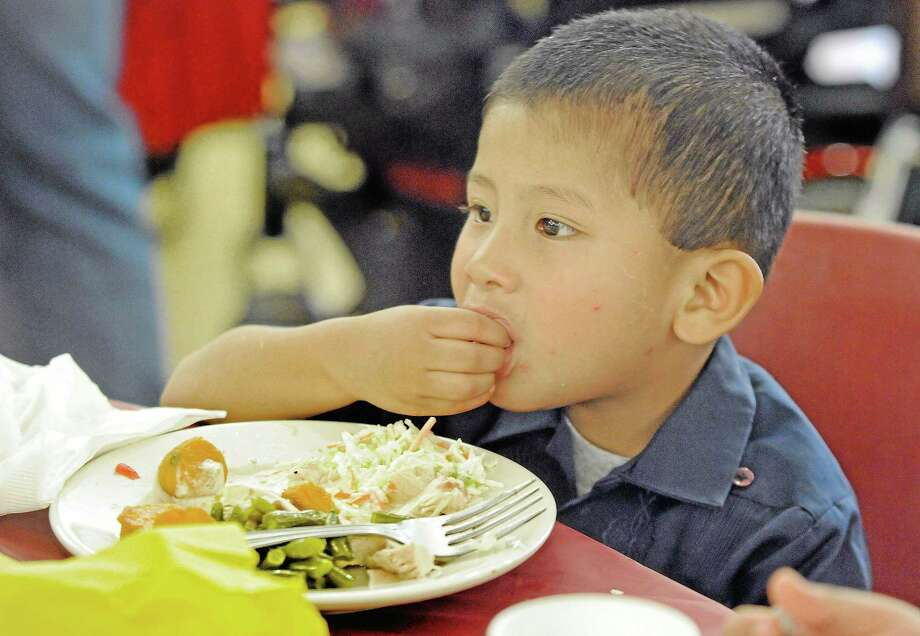 Javier Garcia, 3, of West Chester, Pa., eats during the 29th annual Thanksgiving Dinner celebration at the West Chester Senior Center. Photo: Digital First Media File Photo  / © 2012 Tom Kelly IV
