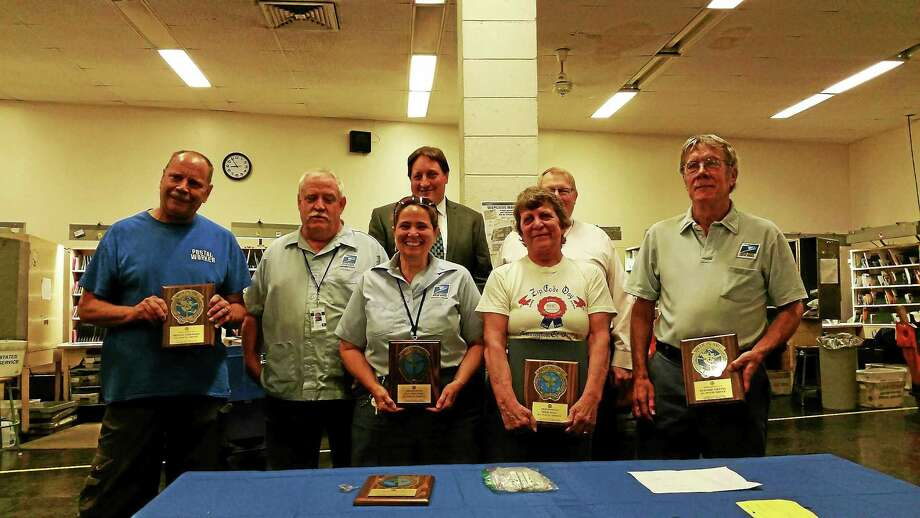 Six postal carriers from the Torrington Post Office were awarded for driving 1 million miles or 30 years without an accident. Photo: Amanda Webster — The Register Citizen