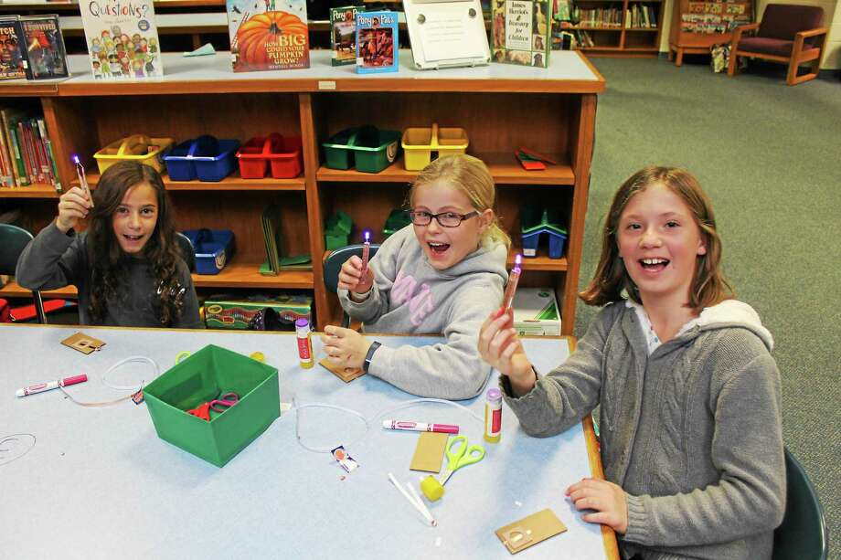 The Harwinton Consolidated School STEM Club meets on Wednesday afternoons in the school library. Photo: Photos By John Nestor