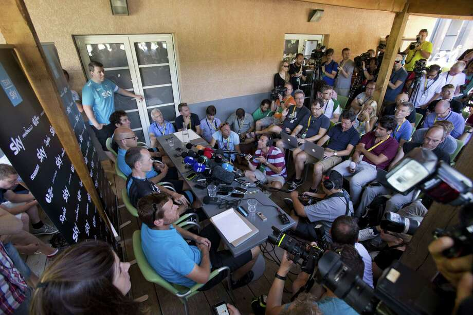 From bottom left at the table, a technical data performance analyst, Britain's Chris Froome, team director Sir Dave Brailsford and Britain's Geraint Thomas attend a press conference during the second rest day of the Tour de France on Tuesday. Photo: Peter Dejong — The Associated Press  / AP 2015