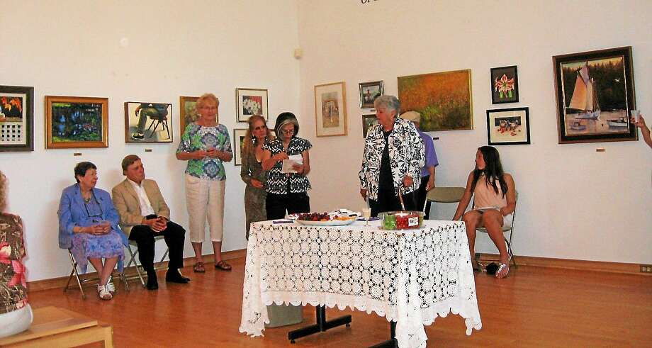 Contributed photo The Watertown Art League presents awards to artists at its 2014 show. The juried show will be held again in May and artists are invited to participate. Photo: Journal Register Co.