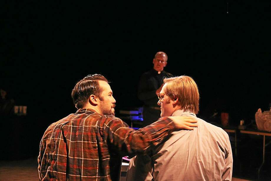 "Photos by Sharon Wilcox  Seated, from left, are Chris Evans (Brian) and Daniel R. Willey (Tom), while in the background is Kevin Dix as Fr. Raymond in the Warner Stage Company's productiono of ""Avow."" Photo: Journal Register Co."