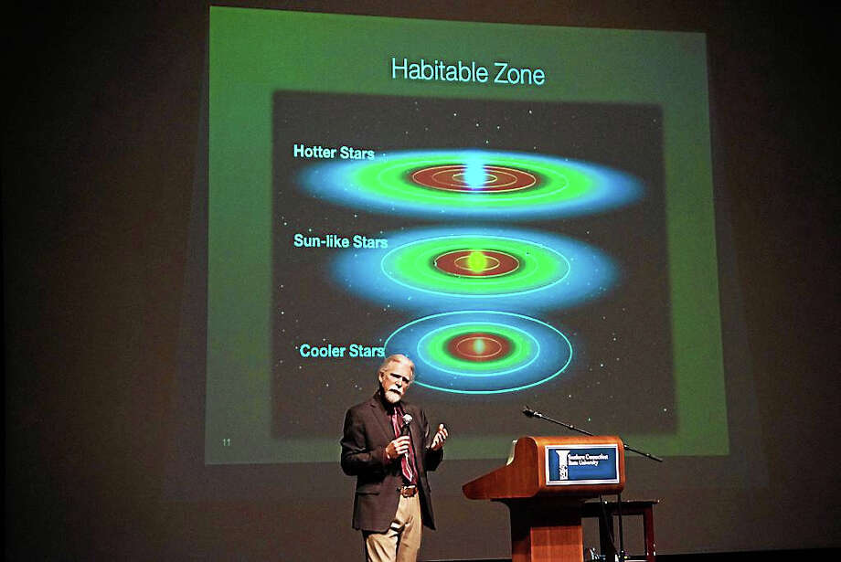 Steve Howell, project scientist for NASA's Kepler Mission, talks about the need for planets to be in a habitable zone – neither too close nor too far away from their sun -- if they are likely to harbor life. Howell was the keynote speaker Monday during an astronomy forum at Southern Connecticut State University. Photo: Journal Register Co. / SCSU
