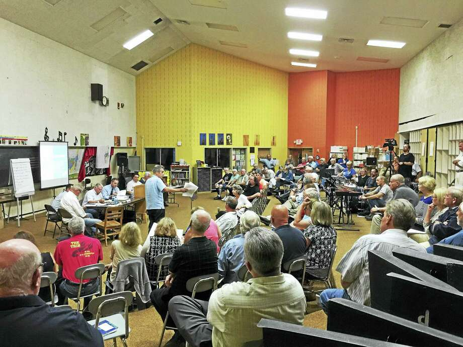 Ben Lambert - The Register Citizen  Residents came out to hear and discuss the proposed new zoning regulations for Winsted in September; the hearing continues Oct. 11. Photo: Journal Register Co.