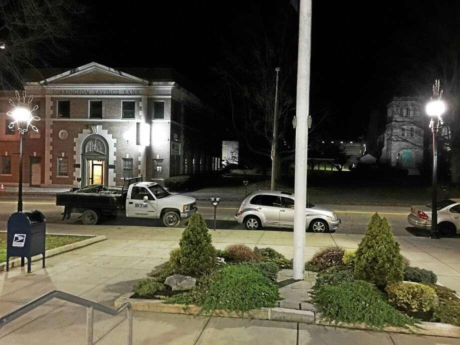 Two streetlights, seen Monday evening from the steps of City Hall in Torrington. Photo: BEN LAMBERT – The Register Citizen