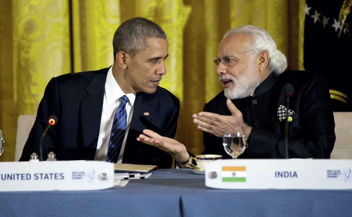 President Barack Obama talks with India's Prime Minister Narendra Modi during a working dinner with heads of delegations of the Nuclear Security Summit in the East Room of the White House, in Washington. After years of being denied entry to the U.S., Modi has become a welcome guest in Washington, forging a surprising bond with President Barack Obama and deepening ties with America.