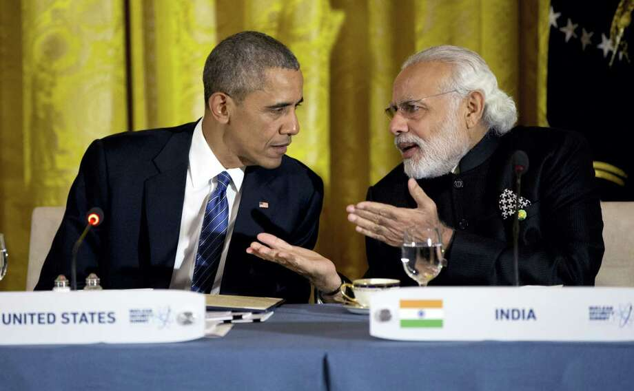 President Barack Obama talks with India's Prime Minister Narendra Modi during a working dinner with heads of delegations of the Nuclear Security Summit in the East Room of the White House, in Washington. After years of being denied entry to the U.S., Modi has become a welcome guest in Washington, forging a surprising bond with President Barack Obama and deepening ties with America. Photo: AP Photo — Carolyn Kaster, File / Copyright 2016 The Associated Press. All rights reserved. This material may not be published, broadcast, rewritten or redistribu