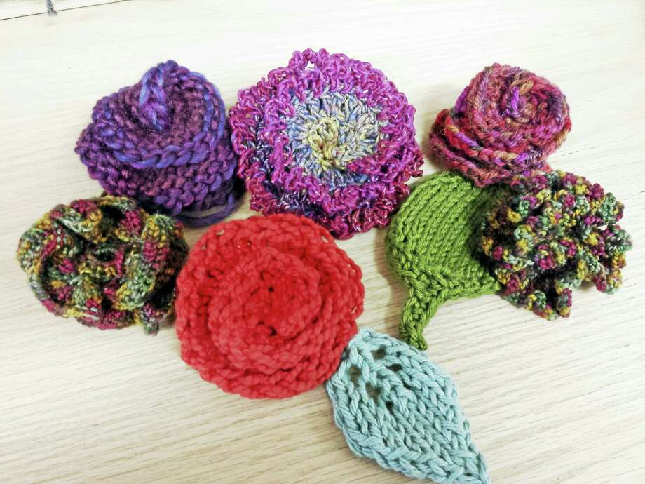 Contributed photo Ginger Balch's creative imagination knows no bounds when it comes to knitting. She's offering a free class at her Torrington shop on Monday, March 26, teaching how to make knitted and crocheted flowers. Photo: Journal Register Co.