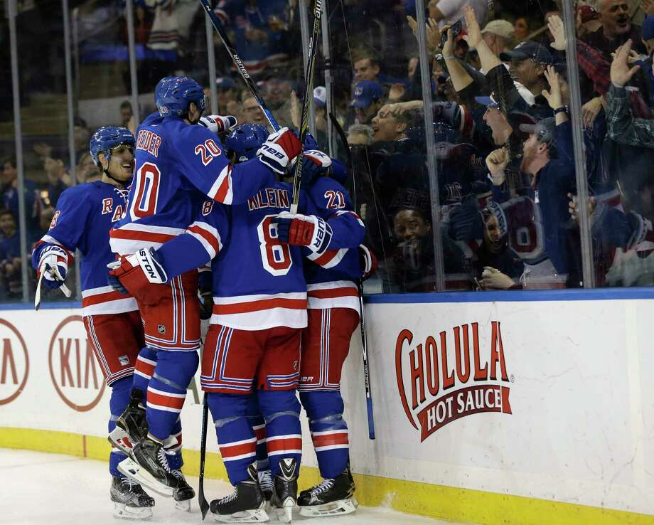 Members of the Rangers celebrate Derek Stepan's goal during the second period against the Maple Leafs on Sunday. Photo: Seth Wenig — The Associated Press  / AP