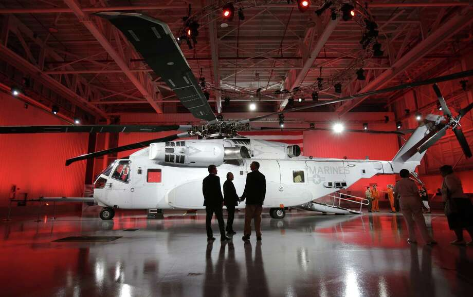 In this May 5, 2014 photo, attendees look at the newly unveiled Sikorsky CH-53K heavy lift helicopter at the Sikorsky Aircraft Corporation in Jupiter, Fla. United Technologies Corp. on June 15, 2015 announced it is shedding helicopter maker Sikorsky. Photo: AP Photo/Wilfredo Lee, File  / AP