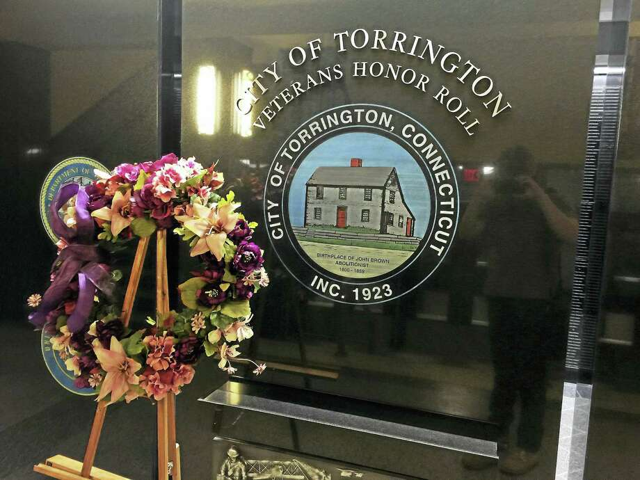 Ben Lambert - The Register Citizen  In honor of Domestic Violence Awareness Month, representatives from the Susan B. Anthony Project and Torrington Mayor Elinor Carbone put a commemorative wreath on display in city hall. Photo: Journal Register Co.