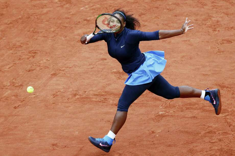 Serena Williams returns the ball during her semifinal match against Kiki Bertens at the French Open on Friday. Photo: Christophe Ena — The Associated Press  / AP