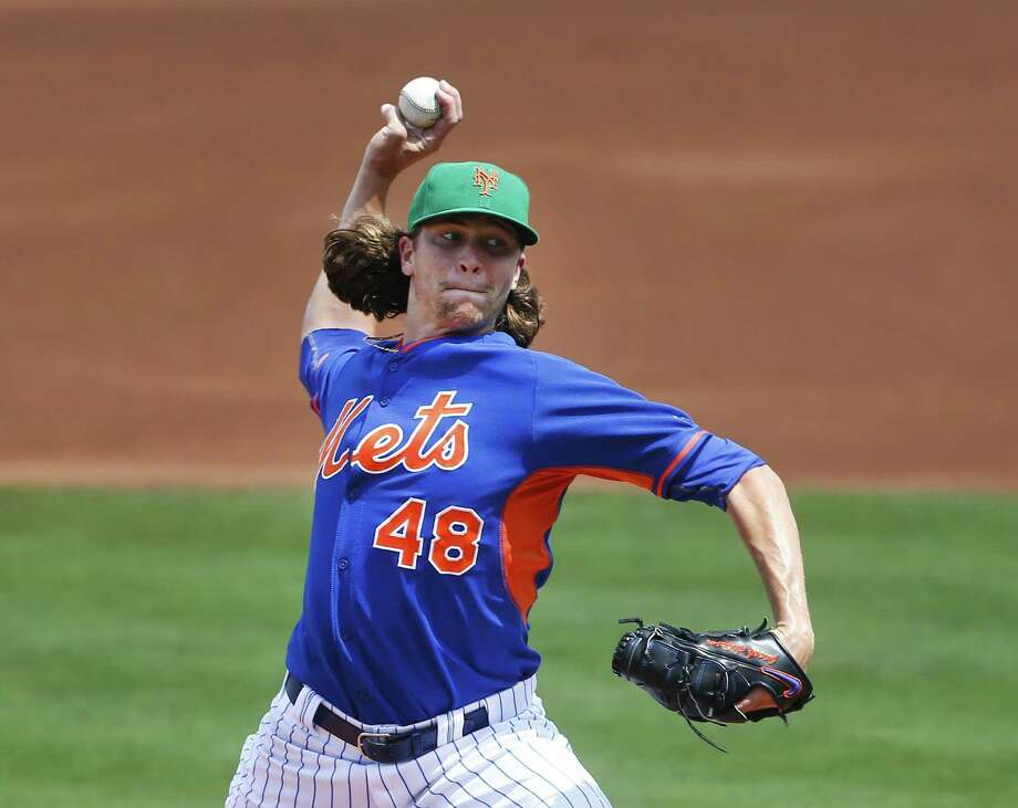New York Mets starter Jacob deGrom works in the first inning of a spring training game Tuesday against the Miami Marlins in Port St. Lucie, Fla. Photo: John Bazemore — The Associated Press  / AP