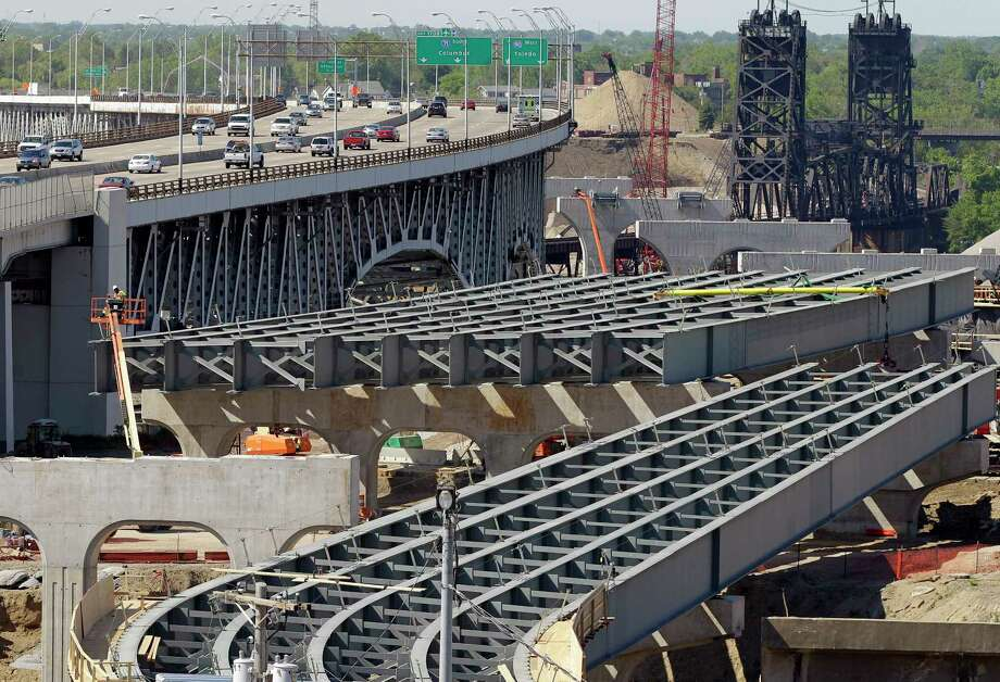 In this May 17, 2012 photo, the steel skeleton for the eastern end of the new Innerbelt Bridge in Cleveland sits next to the existing span. As Congress races to renew the law that pays for national transportation programs, lobbyists are in a frenzy to shape dozens of provisions, from the length of trucks allowed on roads to whether recalled used cars must be repaired before sold and how to pay for bridges and highways. Photo: AP Photo/Mark Duncan, File  / AP