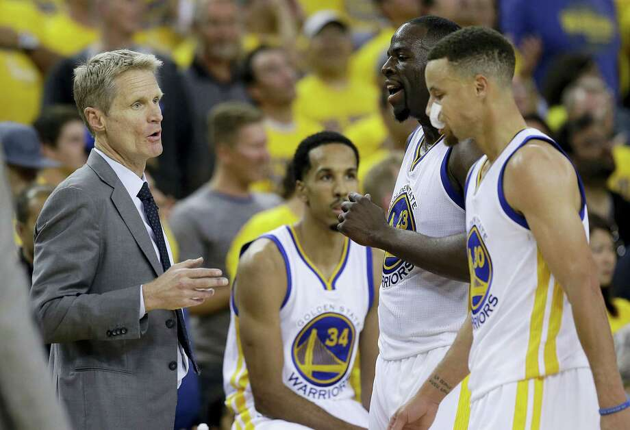 Golden State Warriors head coach Steve Kerr, left, talks with forward Draymond Green (23) and guard Stephen Curry (30) during the second half of Game 1. Photo: Marcio Jose Sanchez — The Associated Press  / AP