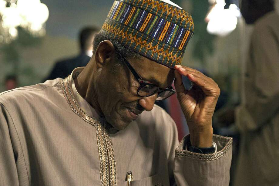 Nigerian President Muhammadu Buhari pauses as he is interviewed by the Associated Press at Blair House in Washington on July 21, 2015. Buhari says a multinational African force will be in place within 10 days to take the fight to the Islamic extremist group Boko Haram that has killed thousands and was behind the abduction of hundreds of schoolgirls. Photo: AP Photo/Cliff Owen  / FR170079 AP
