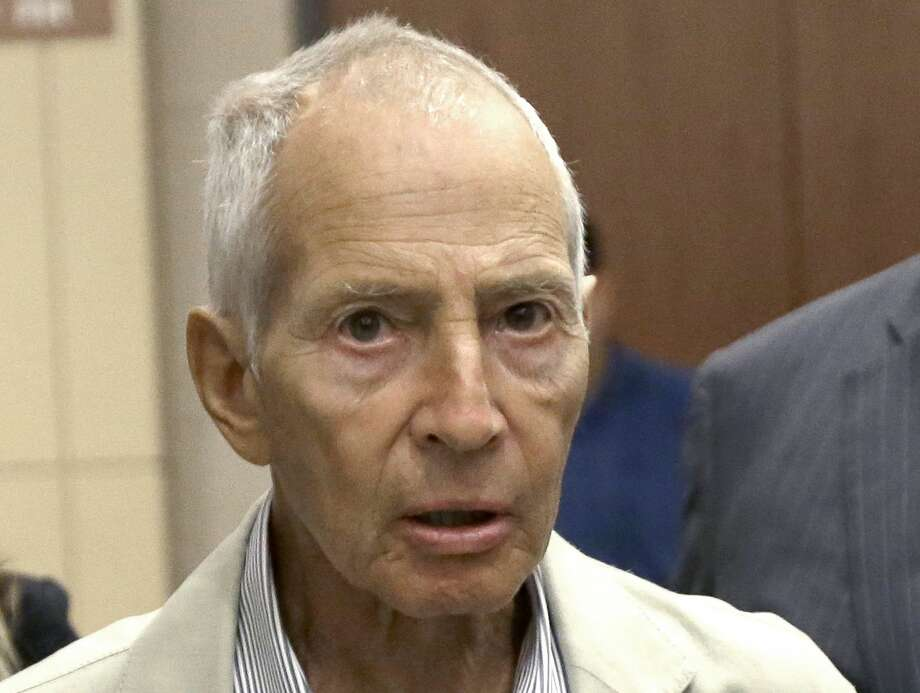 FILE - In this Aug. 15, 2014 file photo, New York City real estate heir Robert Durst leaves a Houston courtroom. Durst was arrested in New Orleans on an extradition warrant to Los Angeles on Saturday, March 14, 2015. (AP Photo/Pat Sullivan, File) Photo: AP / AP
