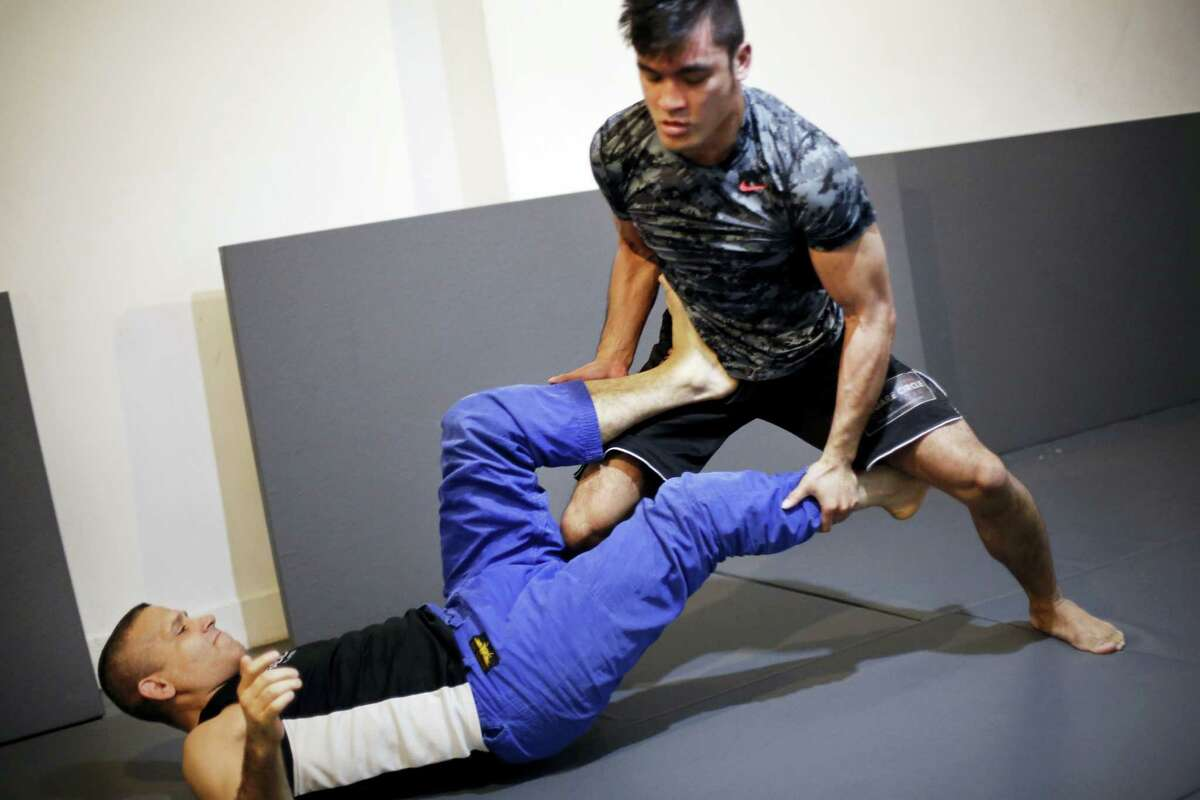 Rene Dreifuss, left, a mixed martial arts coach, trains Richard Callado at Radical MMA NYC, a New York gym, on Tuesday. New York is poised to end its ban on professional mixed martial arts, the last state to prohibit the combat sport.