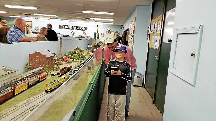 N.F. Ambery photo Dave Waskowitz and his son Dave, 6, operated an electric freight train at the Torrington Area Model Railroaders' event. Photo: Journal Register Co.