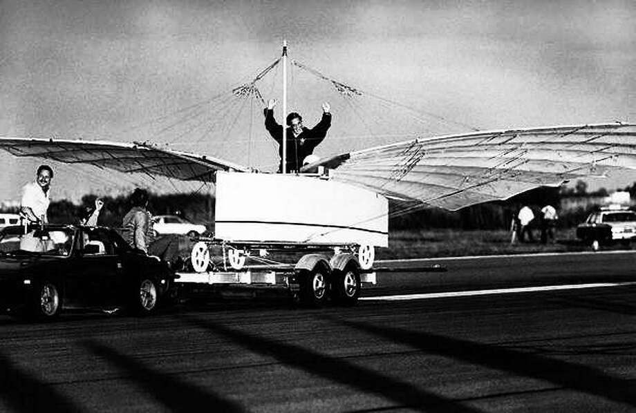Actor Cliff Robertson signals success after he test-piloted a replica of an airplane challenging the Wright brothers' status as the first to fly on Friday morning, July 11, 1986 in a tethered test flight at Sikorsky Memorial Airport in Stratford, Conn. The aircraft, in the test flight, rose off the trailer while being towed. Its builders want to prove that Gustave Whitehead a Connecticut Aviation pioneer, flew in 1901. AP Photo Photo: Journal Register Co.