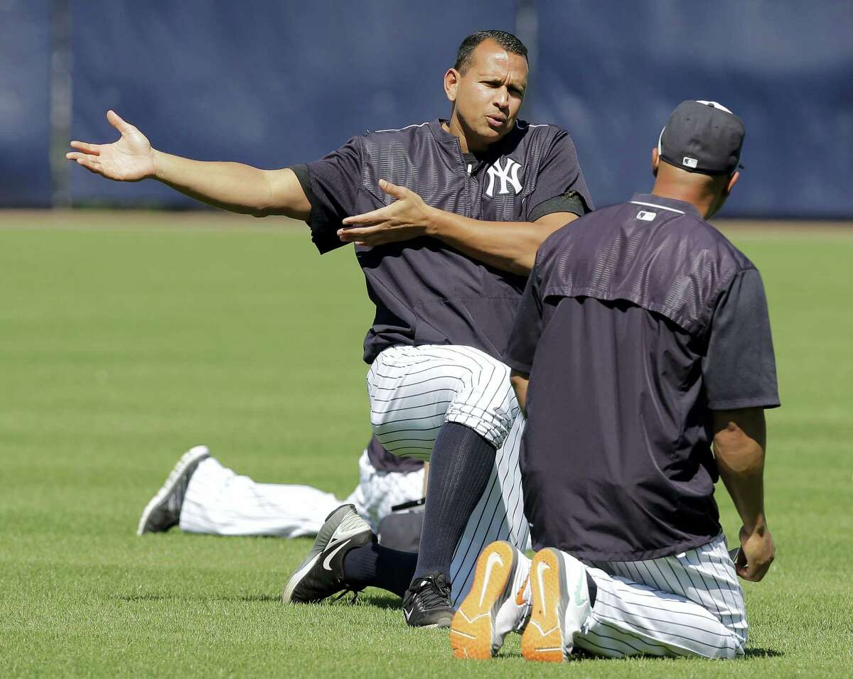 New York Yankees designated hitter Alex Rodriguez gestures as he stretches with Carlos Beltran before a spring training baseball game against the New York Mets Tuesday, March 22, 2016, in Tampa, Fla. (AP Photo/Chris O'Meara)