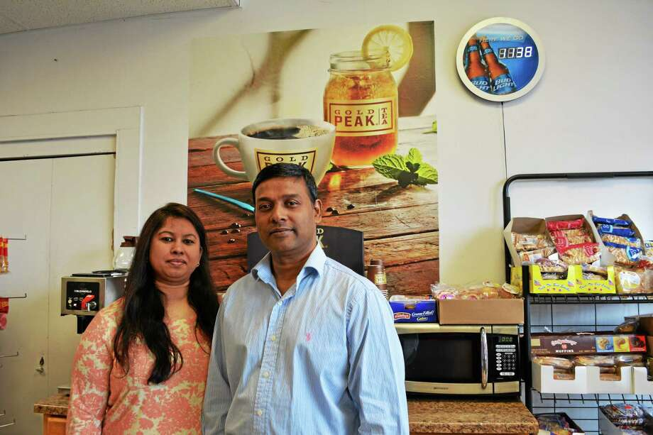 Tahsina and Shahidul H. Chowdhury, owners of Shawn's Mini Market on 35 Water St. in Torrington, are opening an Indian restaurant at 57 Water St. Photo: Amanda Webster — The Register Citizen