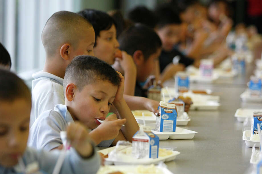 First-graders enjoy a meal at Port of Houston Elementary School in 2013. Photo: Johnny Hanson, Staff / © 2013  Houston Chronicle